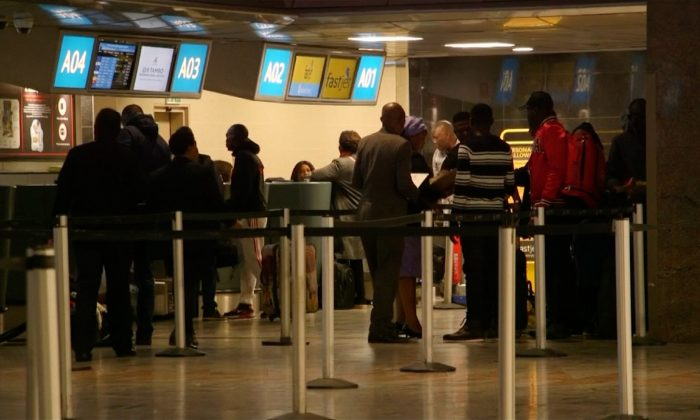 Nigerians at check-in counters in Johannesburg, South Africa on Sept. 5, 2019. (Screenshot taken from video/Reuters)