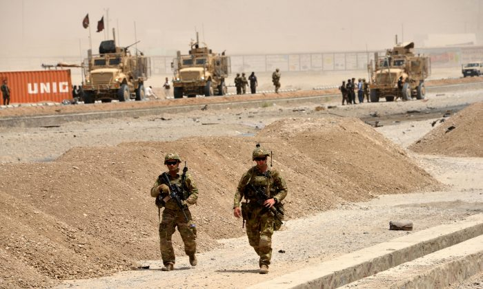 U.S. soldiers walk at the site of a Taliban suicide attack in Kandahar on Aug. 2, 2017.(Javed Tanveer/AFP/Getty Images)