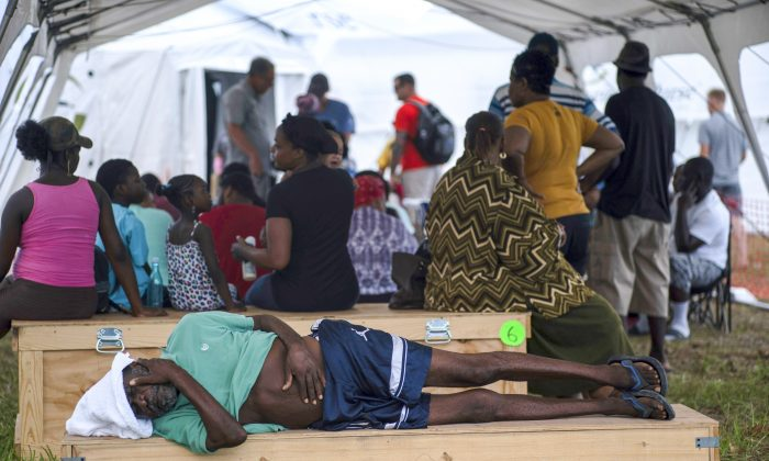 An man rests at a tent-hospital set up by Samaritan's Purse in the aftermath of Hurricane Dorian in Freeport, Bahamas, on Sept. 10, 2019. (Ramon Espinosa/AP)