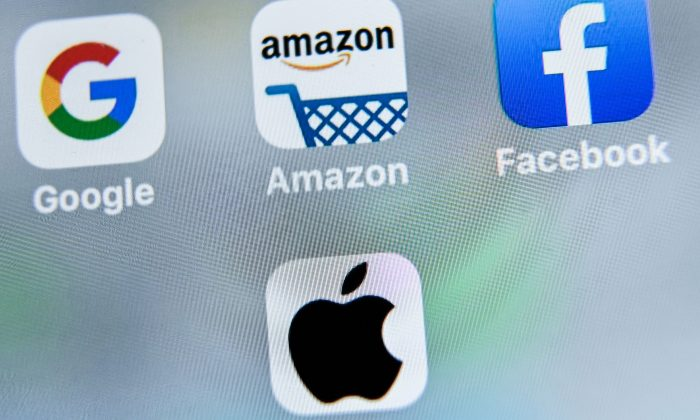 The apps of Google, Amazon, Facebook and Apple on Aug. 28, 2019. (Denis Charlet/AFP/Getty Images)