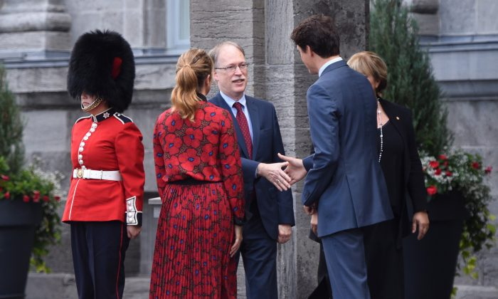 Prime Minister Justin Trudeau shakes hands with Ian Shugart, Clerk of the Privy Council, as he and Sophie Gregoire Trudeau arrive at Rideau Hall in Ottawa, on Sept.11, 2019, to ask   Gov.Gen. Julie Payette to dissolve parliament which will trigger a federal election. (The Canadian Press/Sean Kilpatrick)