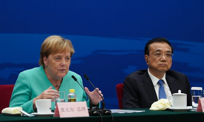 Chancellor of Germany Angela Merkel (L) gives a speech next to Chinese Premier Li Keqiang during the German-Chinese Dialogue Forum at the Great Hall of the People in Beijing on Sept. 6, 2019. (Andrea Verdelli/AFP/Getty Images)