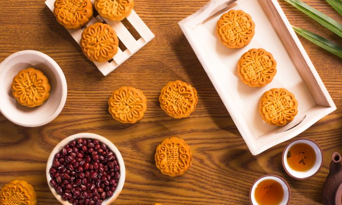 Traditional mooncakes, served with tea. (Shutterstock)