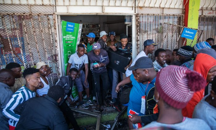 Looters take items from an alleged foreign-owned shops during a riot in Johannesburg, South Africa, on Sept. 2, 2019.  (Michele Spatari/AFP/Getty Images)