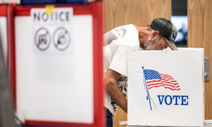 A man casts a vote during a special election in North Carolina's 9th Congressional District in Charlotte, N.C., on Sept. 10, 2019. (Sean Rayford/Getty Images)