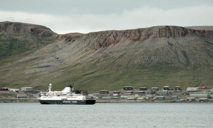 A ship is docked at the community of Arctic Bay, Nunavut, on Aug. 1, 2019. (THE CANADIAN PRESS/Sean Kilpatrick)
