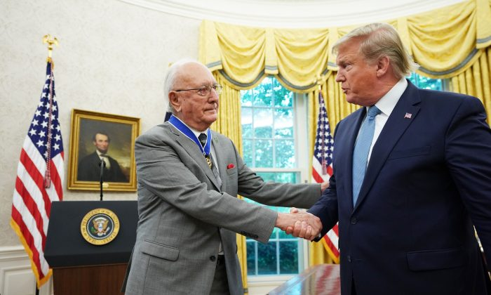 President Donald Trump shakes hands with Celtics basketball legend Bob Cousy after presenting the Presidential Medal of Freedom in the Oval Office of the White House in Washington on Aug. 22, 2019. (Mandel Ngan/AFP/Getty Images)