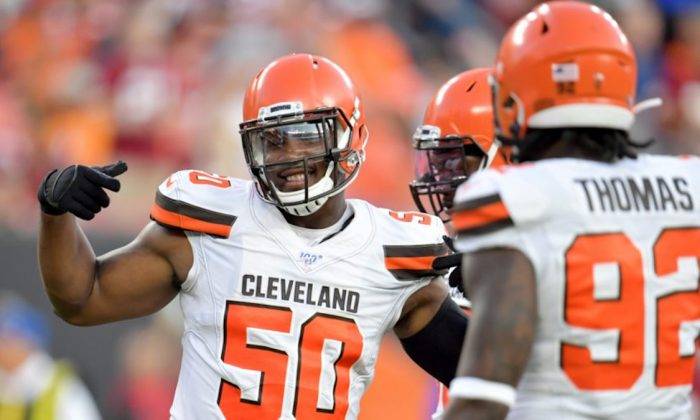 Defensive end Chris Smith #50 of the Cleveland Browns celebrates during the first half of a preseason game against the Washington Redskins at FirstEnergy Stadium in Cleveland, Ohio, on Aug. 8, 2019. (Jason Miller/Getty Images)