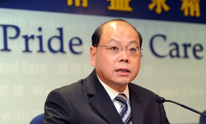 Then Hong Kong Commissioner of police Andy Tsang Wai-hung addresses the media during a press conference in Hong Kong on March 12, 2014. (Laurent Fievet/AFP/Getty Images)