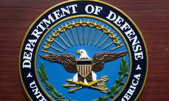 The U.S. Department of Defense seal is seen on the lecturn in the media briefing room at the Pentagon in Washington, DC, on December 12, 2013. (PAUL J. RICHARDS/AFP/Getty Images)