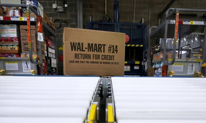 A box of merchandise is unloaded from a truck and sent along a conveyor belt at a Walmart Supercenter in Houston on Nov. 9, 2018. (David J. Phillip/File Photo via AP)