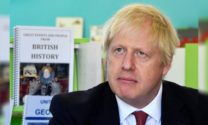 Britain's Prime Minister Boris Johnson speaks with year four and year six pupils during a visit to Pimlico Primary school on Sept. 10, 2019 in London, England. (Toby Melville/WPA Pool/Getty Images)