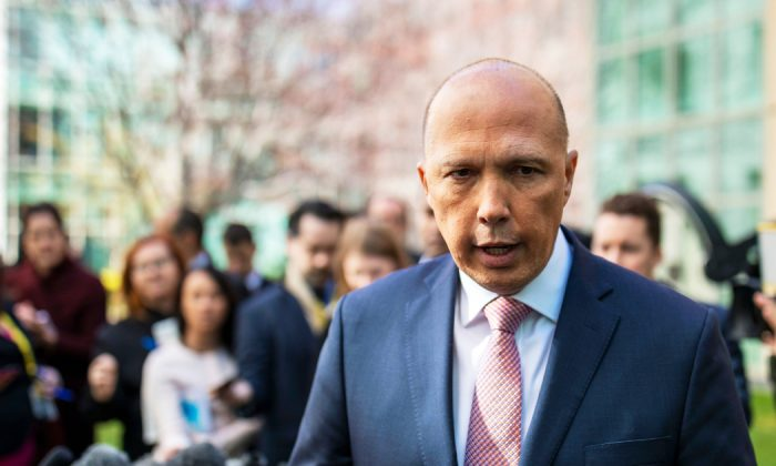 Australian Home Affairs Minister Peter Dutton  faces the media at a press conference in Canberra on Aug. 21, 2018. (Sean Davey/AFP/Getty Images)