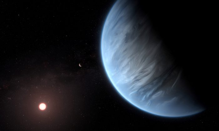 An artist's impression released by NASA shows the planet K2-18b, its host star and an accompanying planet, on Sept. 11, 2019. (ESA/Hubble/M. Kornmesser/NASA Handout via REUTERS)