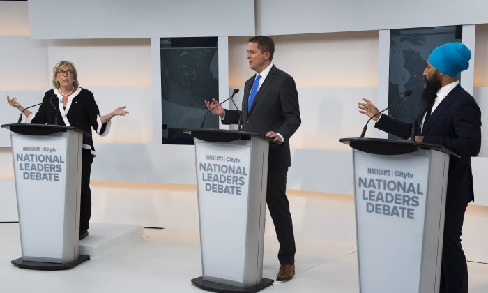 (L-R) Green Party Leader Elizabeth May, Conservative Leader Andrew Scheer, and NDP Leader Jagmeet Singh take part during the Maclean's/Citytv National Leaders Debate in Toronto on Sept. 13, 2019. (THE CANADIAN PRESS/Frank Gunn)