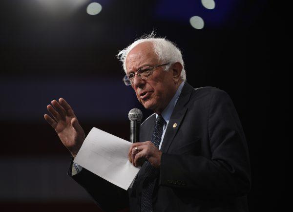 Bernie Sanders speaks on stage