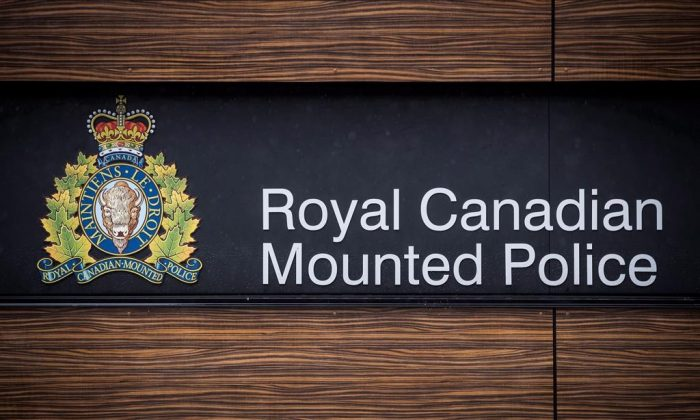 "The RCMP has charged one of its own with several offences under Canada's official secrets law. The RCMP logo is seen outside Royal Canadian Mounted Police ""E"" Division Headquarters, in Surrey, B.C., in this file photo. The national police force says Cameron Ortis was charged under three sections of the Security of Information Act along with two Criminal Code offences. (The Canadian Press/Darryl Dyck)"