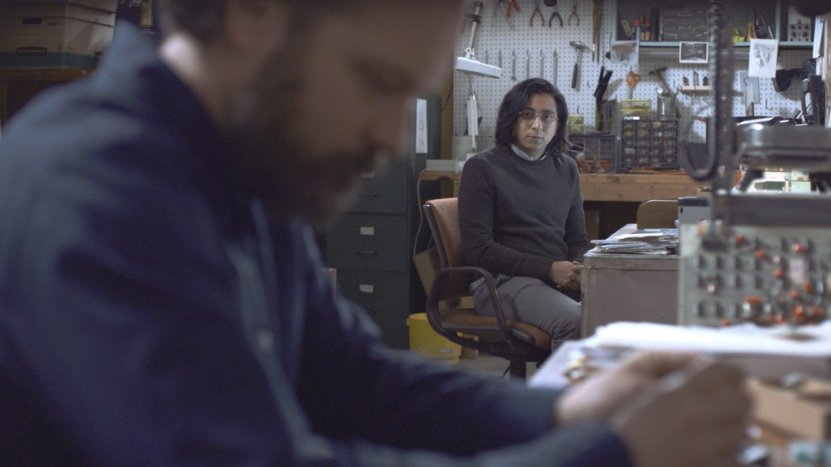 two men in a homemade lab