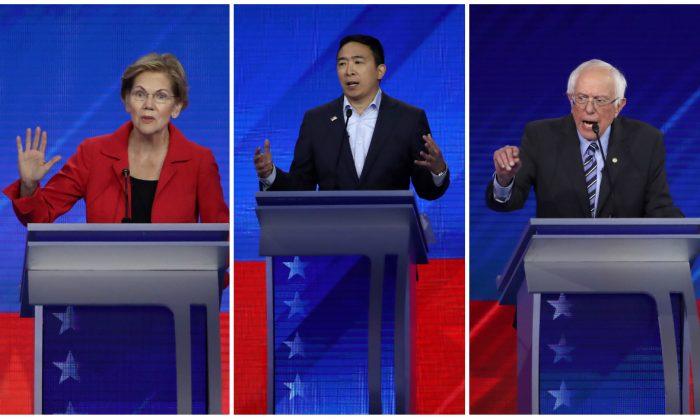 Sen. Elizabeth Warren (D-Mass.), left, entrepreneur Andrew Yang, center, and Sen. Bernie Sanders (I-Vt.), right, speak during the Democratic presidential debate in Houston, Texas on Sept. 12, 2019. (Win McNamee/Getty Images)