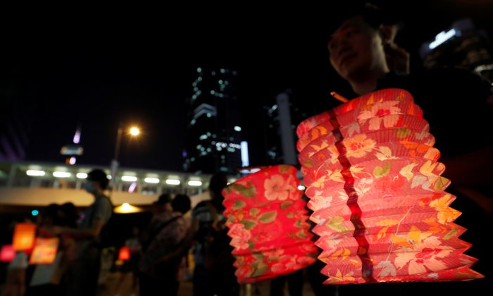 People hold traditional lanterns as they gather to form a human chain during the Mid-Autumn Festival at Lennon Wall at Admiralty district in Hong Kong, China on Sept. 13, 2019. (Amr Abdallah Dalsh/Reuters)