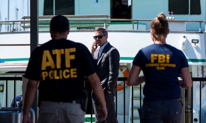 Investigators check the Truth Aquatics office on the Santa Barbara Harbor in Santa Barbara, Calif., on Sept. 8, 2019.  (Christian Monterrosa/AP Photo)