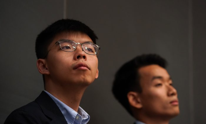 Joshua Wong (L), Hong Kong student activist and politician and Brian Leung Kai-ping, graduate student of the University of Washington,attends a panel discussion in a Weatherhead East Asian Institute Event on Anti-Extradition Law Movement in Hong Kong at Columbia Law School in New York, N.Y., on Sept. 13, 2019. (Timothy A. Clary/AFP/Getty Images)
