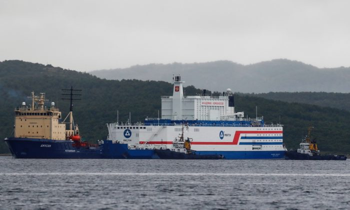 Russia's floating nuclear power plant Akademik Lomonosov and tugboat Dixon before the departure from the service base of Rosatomflot company for a journey along the Northern Sea Route to Chukotka in Murmansk, Russia, on Aug. 23, 2019. (Maxim Shemetov/Reuters)