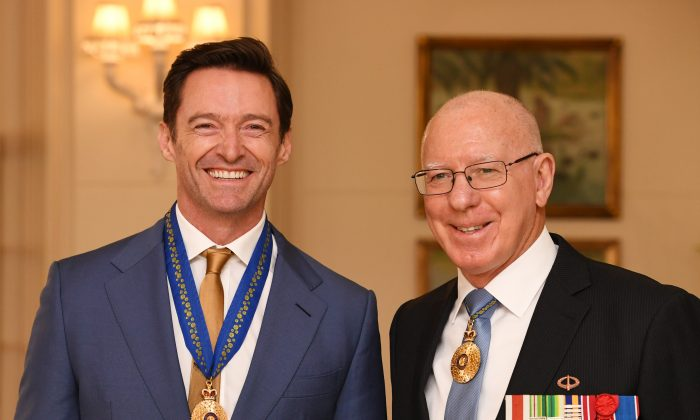 Australian actor Hugh Jackman is awarded an Order of Australia by The Governor-General of Australia David Hurley at Government House on Sept. 13, 2019 in Melbourne, Australia. (Tracey Nearmy/Getty Images)