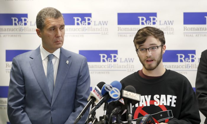 Adam Hergenreder (R) responds to a question as attorney Antonio Romanucci listens during a news conference in Chicago on Sept. 13, 2019. (Charles Rex Arbogast/AP Photo)