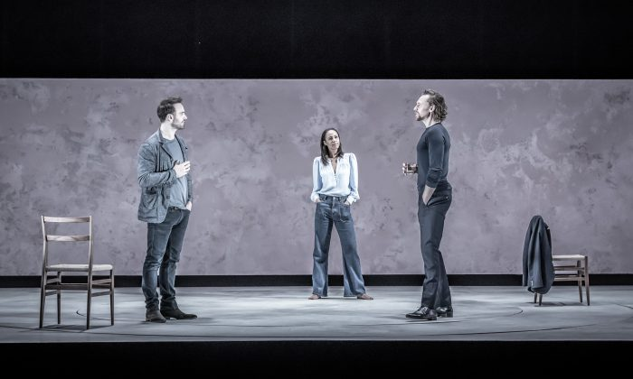 """(L–R) The spare set and muted colors of the set and costumes focus audience attention on the nuances of the relationships. Charlie Cox, Zawe Ashton, and Tom Hiddleston star in """"Betrayal,"""" here in London's Harold Pinter Theatre. (Marc Brenner)"""