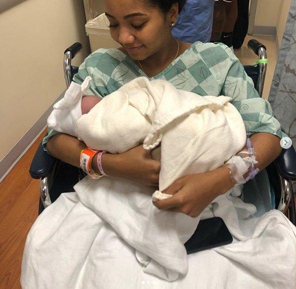 Chris Smith's girlfriend Petara Cordero holds daughter