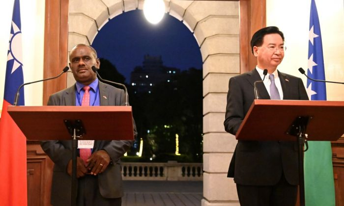 Taiwan's Foreign Minister Joseph Wu (R) takes part in a press conference with Solomon Islands' Foreign Minister Jeremiah Manele (L) in Taipei on Sept. 9, 2019. (Sam Yeh/AFP/Getty Images)