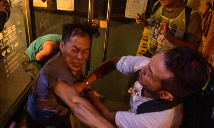 Two people broke into a fight during a protest in Hong-Kong on Sept. 15, 2019. (Nicolas Asfouri/AFP/Getty Images)