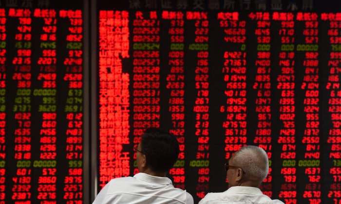 Investors monitor stock price movements at a securities company in Beijing on June 15, 2016. (Greg Baker/AFP/Getty Images)