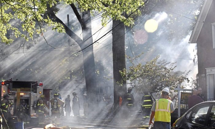 First responders work at the scene of a house fire in Edgewood, Pa,. on Saturday, Sept. 14, 2019. (Christian Snyder/Pittsburgh Post-Gazette via AP)