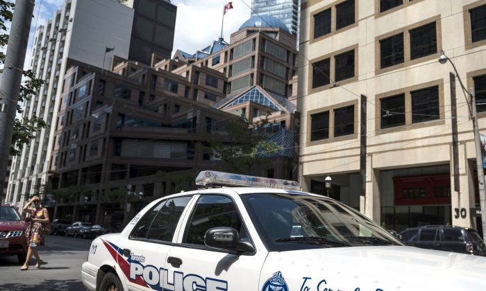 A police cruiser is parked in front of the Toronto Police Services headquarters in Toronto on Aug. 9, 2019. (THE CANADIAN PRESS/Christopher Katsarov)