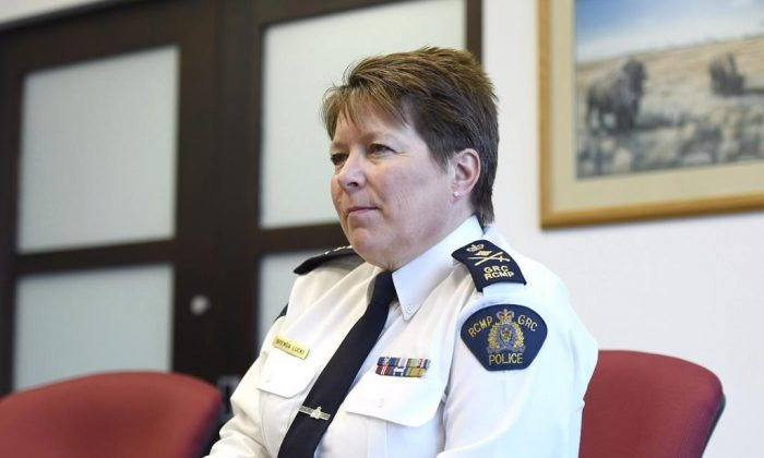 RCMP commissioner Brenda Lucki in a file photo. Lucki says the Mounties are assessing and trying to mitigate the possible damage that may have been caused in light of the arrest of one of its senior intelligence officials. (The Canadian Press/Justin Tang)
