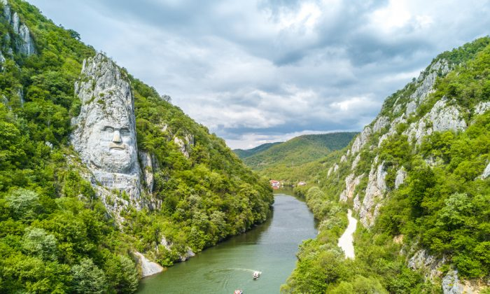 The head of Decebalus, a Romanian hero, overlooks the Danube River.