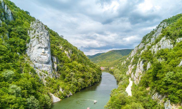 The head of Decebalus, a Romanian hero, overlooks the Danube River. (Calin Stan/Shutterstock)