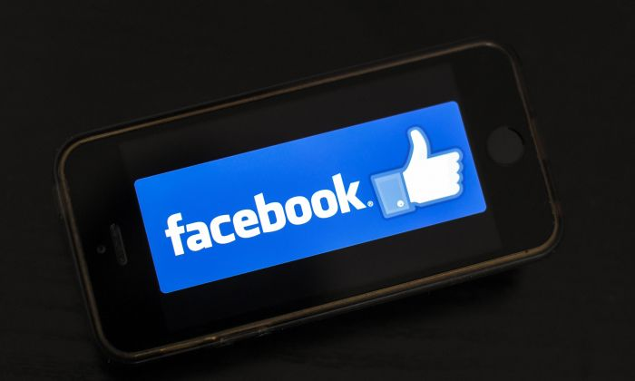 The logo of social network Facebook is displayed on a smartphone in France on January 15, 2019. (LOIC VENANCE/AFP/Getty Images)