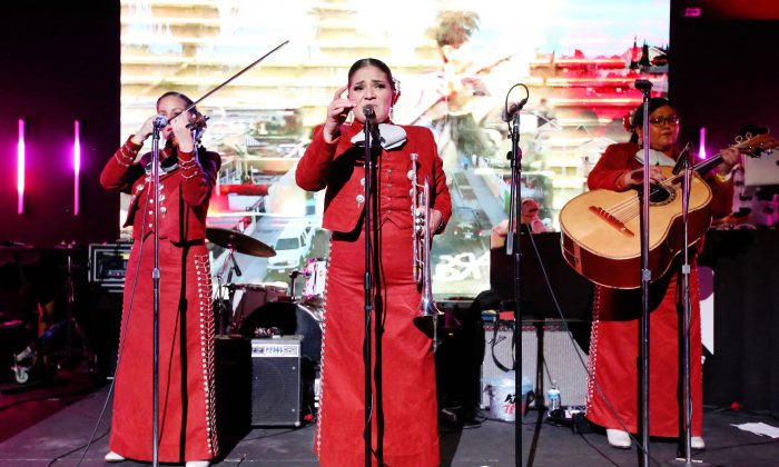 Lindas Mariachis Mexicans perform onstage during during Tecate Celebrates Mexican Independence Day With Launch Party For Los Angeles Lindo Y Querido Compilation in Los Angeles on Sept. 12, 2019. (Jesse Grant/Getty Images for Tecate)