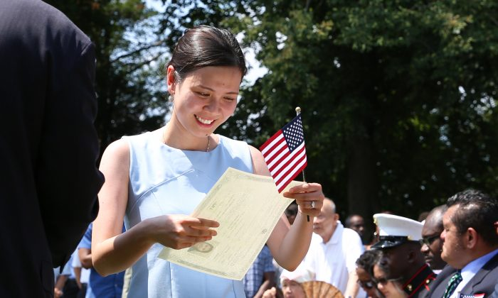Thao Tran from Vietnam at a naturalization ceremony for America's 100 newest citizens near the Mansion takes place during Independence day events at President George Washington's historic home in Mount Vernon, Va., on July 4, 2018. (Samira Bouaou/The Epoch Times)