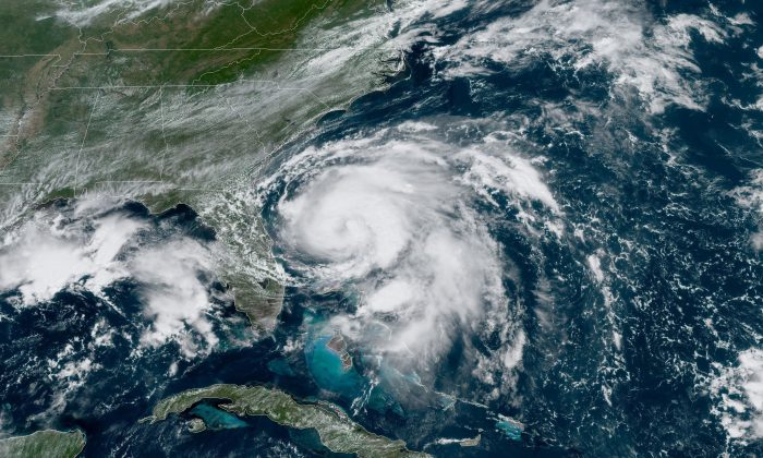 Humberto has been upgraded to a hurricane as it moves farther east into the Atlantic Ocean and away from land. (NOAA)