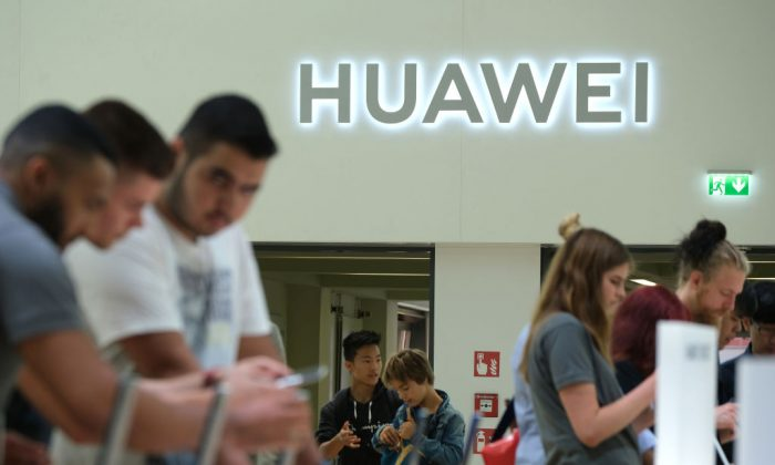 Visitors check out new Huawei smartphones at the 2019 IFA home electronics and appliances trade fair in Berlin on Sept. 6, 2019. (Sean Gallup/Getty Images)