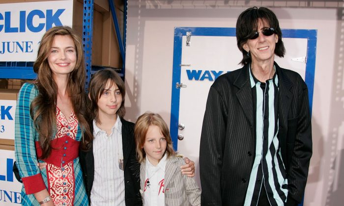 """Musician Ric Ocasek, (R) wife Paulina Porizkova (L) and their children arrive at Sony Pictures premiere of """"Click"""" held at the Mann Village Theater on June 14, 2006 in Westwood, California.  (Photo by Kevin Winter/Getty Images)"""