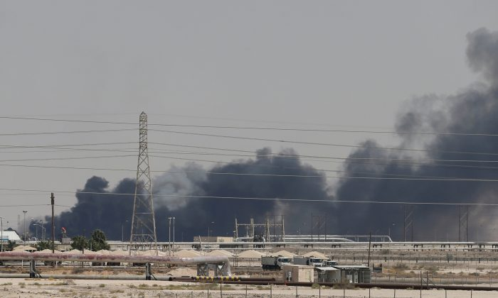 Smoke is seen following a fire at Aramco facility in the eastern city of Abqaiq, Saudi Arabia, Sept. 14, 2019. (Reuters/Stringer)