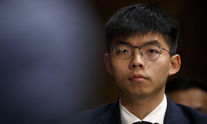 Hong Kong activist Joshua Wong, listens during a congressional hearing on the Hong Kong protests, on Sept. 17, 2019, in Washington. (AP Photo/Jacquelyn Martin)