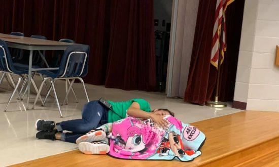 'Angel' Custodian Comforts Autistic Girl at Texas School