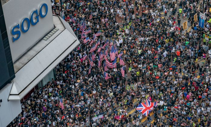 Protesters wave U.S flags as they gather ahead of a pro-democracy march in Hong Kong on Sept. 15, 2019. (Anthony Kwan/Getty Images)