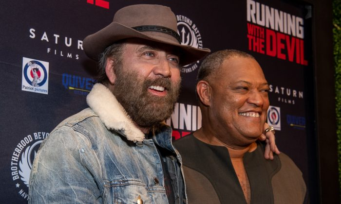Laurence Fishburne (R) and Nicolas Cage attend the premiere of Quiver Distribution's 'Running with the Devil' at Writers Guild Theater in Beverly Hills, California on Sept. 16, 2019. (Photo by Emma McIntyre/Getty Images)